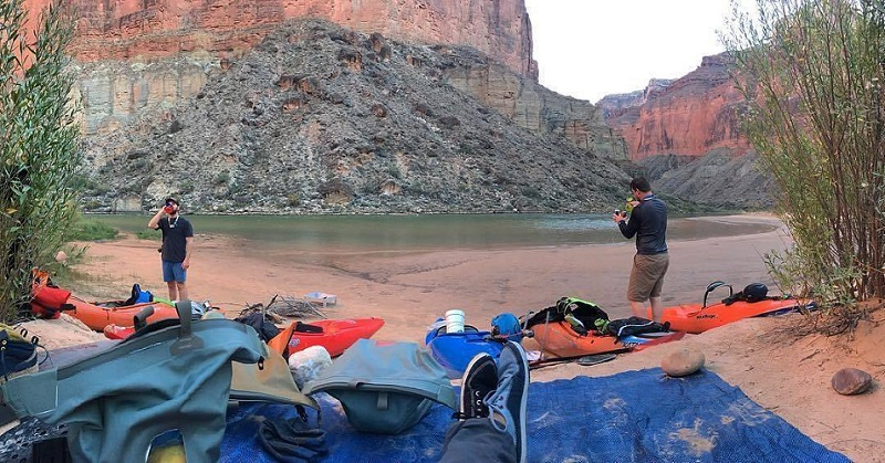 Campsite by the river and canyon with watershed drybags in view