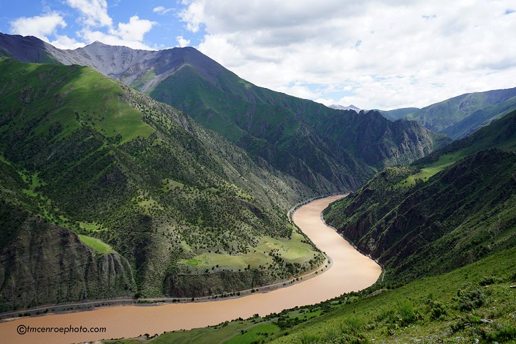 Shot of a river winding through the mountains in Tibet