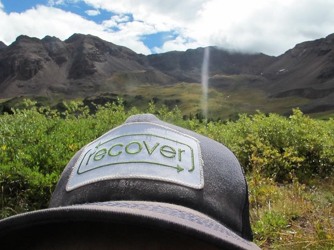 Recover Brands Hat with Mountains in the background