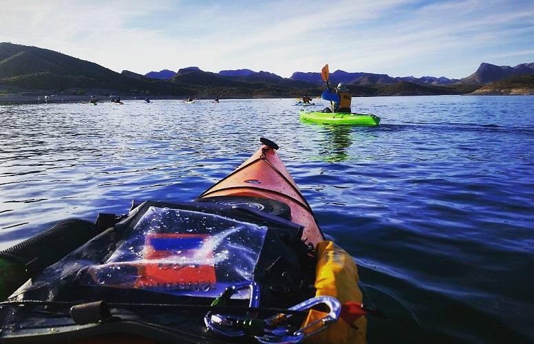 Aleutian Deck Bag on a kayak while paddling on a lake