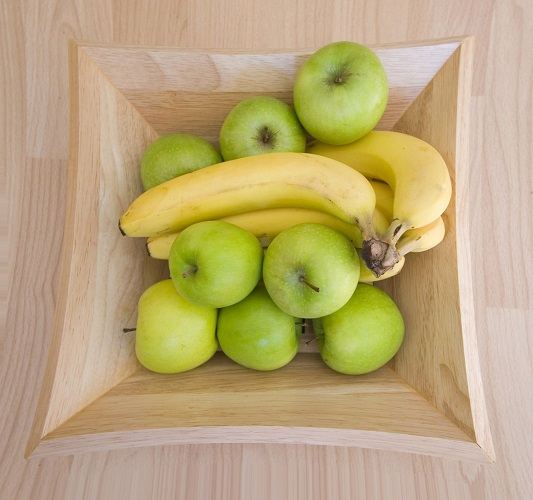 Banana and apples in a bowl